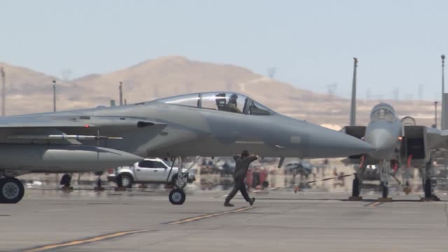 vídeos de stock, filmes e b-roll de eagle taxis out for takeoff during red flag 143 jul 23 2014 at nellis air force base nev the concept of red flag was developed by maj moody suter to... - nellis air force base