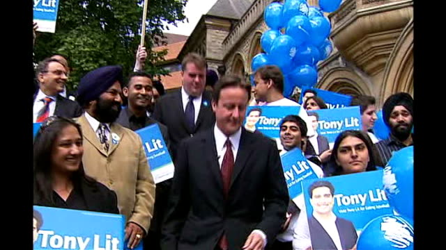 ealing southall by-election; england: london: ealing: ext david cameron mp along with local party supporters carrying posters in support of tony lit... - candidate stock videos & royalty-free footage