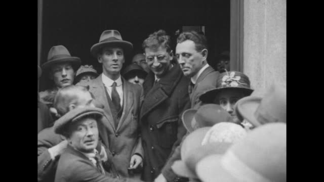 eamon de valera and austin stack stand in doorway with jubilant supporters after their release from arbour hill prison in dublin - sinn fein stock videos & royalty-free footage
