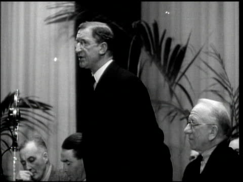 eamon de valera standing, speaking at fianna fail party headquarters political meeting, angled audience of men believed to be delegates applauding.... - republic of ireland stock videos & royalty-free footage