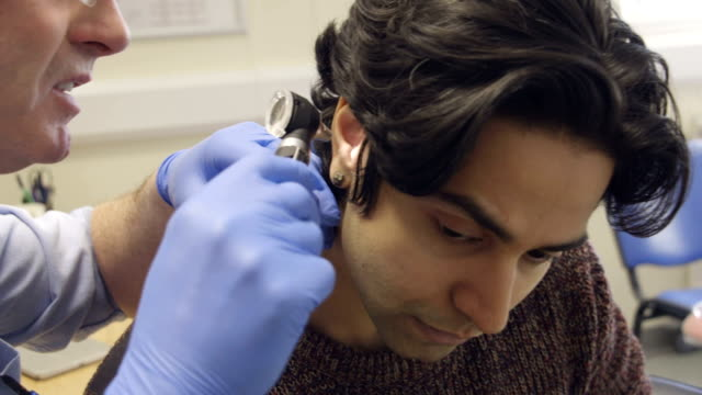 ear examination - extreme close up stock videos & royalty-free footage