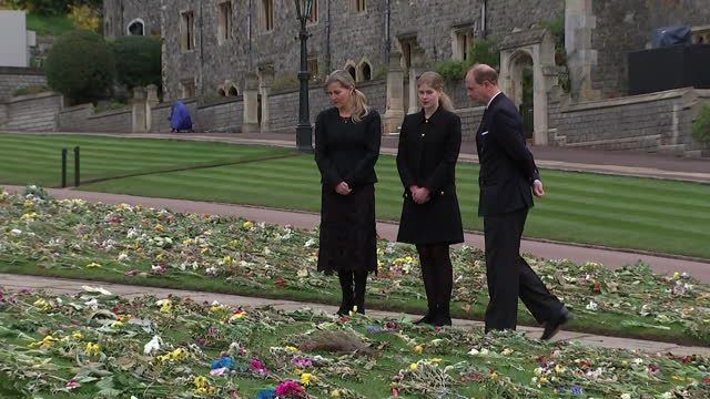"""earl and countess of wessex and their daughter lady louise windsor, view floral tributes outside st george's chapel, windsor, following the death of... - """"bbc news"""" stock-videos und b-roll-filmmaterial"""