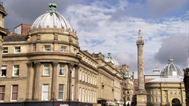 earl grey's monument towers between two domes on grey street in newcastle upon tyne, england. available in hd. - newcastle upon tyne stock videos and b-roll footage