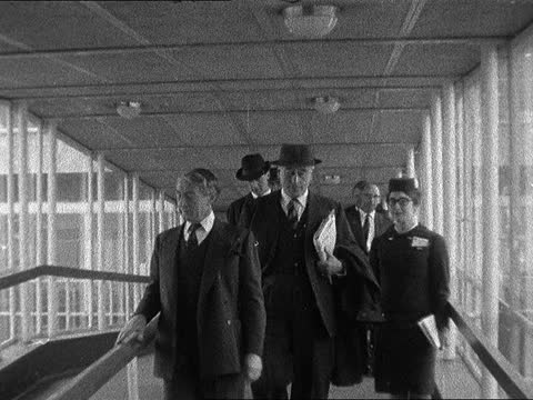 earl mountbatten leaves for naples; england: london: lap ; int louis mountbatten walks along ramp towards with sir solly zuckerman neg 16mm brenards - itv evening bulletin stock videos & royalty-free footage