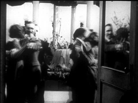 b/w early 1920s couples dancing at dancing master's convention / nyc / newsreel - 舞踏会点の映像素材/bロール