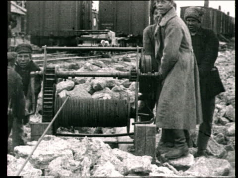 early 1920s montage b/w men working on reconstruction of damaged railways after russian civil war/ russia - provincial reconstruction team stock videos & royalty-free footage