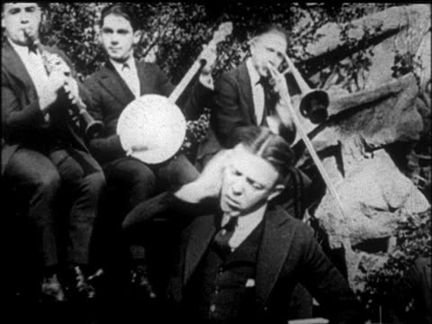 b/w early 1920s pat rooney ii dancing / tokyo five jazz band in background / nyc / newsreel - banjo stock videos & royalty-free footage