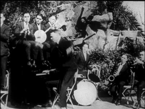 b/w early 1920s pat rooney ii dancing wacky dance / tokyo five jazz band in background / nyc / newsreel - performance group stock videos and b-roll footage