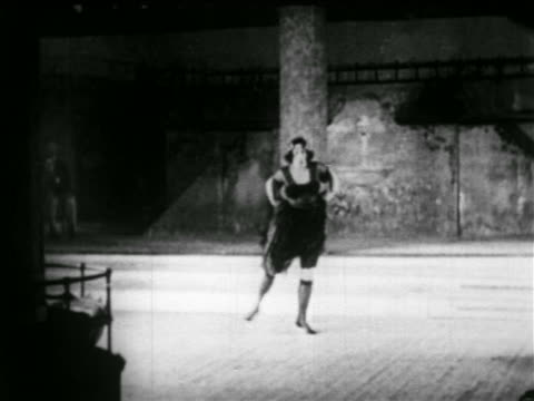 b/w early 1920s woman dancing on stage of nightclub / nyc / newsreel - 1920 stock-videos und b-roll-filmmaterial