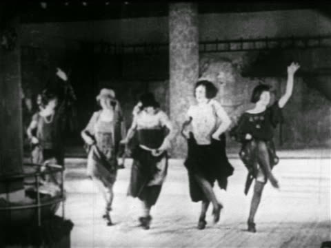 B/W early 1920s women in chorus line rehearsing on stage of nightclub / NYC / newsreel