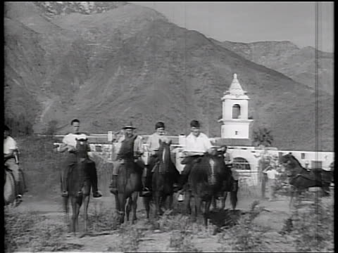 b/w early 1930s people riding horses on resort / mountains in background / california / newsreel - 1930 stock videos and b-roll footage