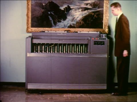 early 1950s businessman standing next to card reader machine sorting punch cards - punch card stock videos & royalty-free footage