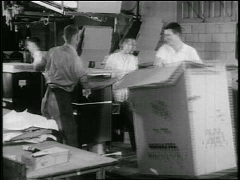 b/w early 1950s men boxing television set on assembly line in rca factory - interconnect plug stock videos & royalty-free footage