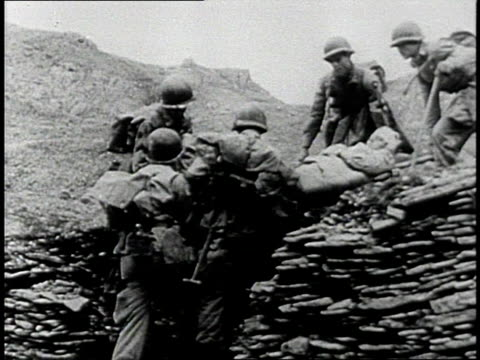 early 1950s montage soldiers carrying a wounded man on a stretcher / south korea - korean war stock videos & royalty-free footage