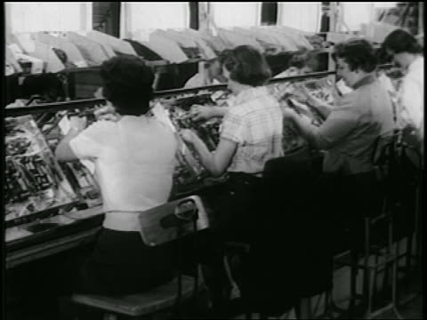 b/w early 1950s seated women working on tvs moving slowly on conveyor belt in rca factory - interconnect plug stock videos & royalty-free footage