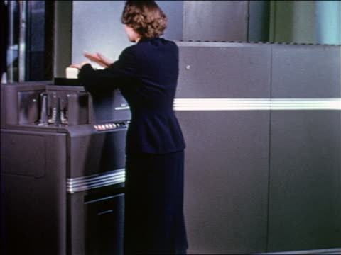 early 1950s woman preparing stack of punch cards for large computer - punch card reader stock videos & royalty-free footage