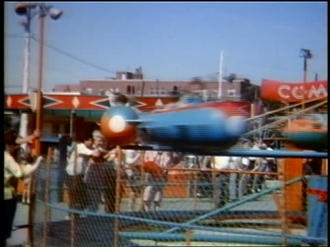 early 1960s children on spinning rocket amusement ride / queens, ny / home movie - around the fair n.y stock videos & royalty-free footage