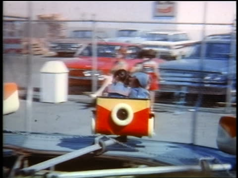 early 1960s pan two small girls on spinning amusement ride / queens, ny / home movie / jump cuts - around the fair n.y stock videos & royalty-free footage