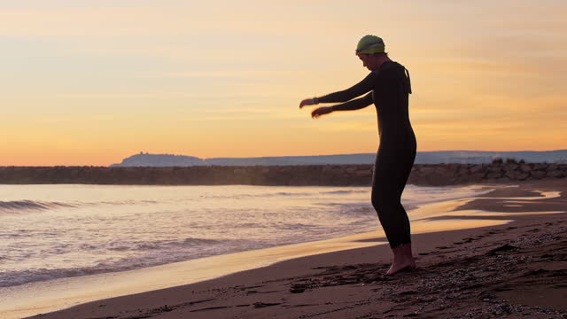 "early 50s female triathlete training on costa brava beach - xavierarnau or ""xavier arnau serrat"" stock videos & royalty-free footage"