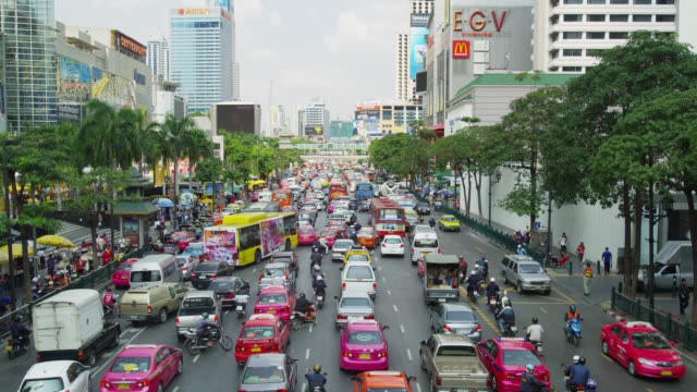 early afternoon traffic on rachadamri street, bangkok, thailand - stationary stock videos & royalty-free footage