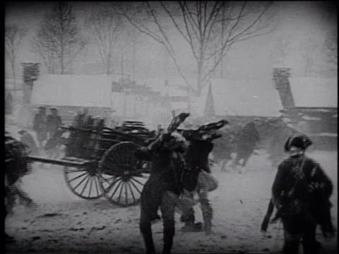 1945 reenactment early american settlers during a snowstorm / valley forge, pennsylvania, united states - frank capra video stock e b–roll