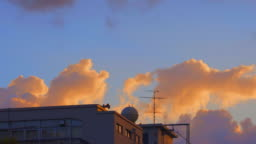Early clouds flowing in the twilight sky