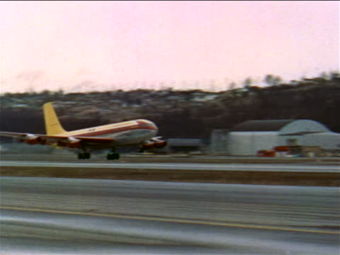 stockvideo's en b-roll-footage met 1956 pan early commercial jet-powered plane taking off from runway / industrial - prelinger archief
