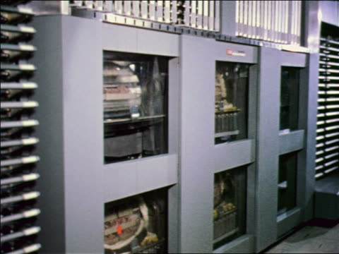 1957 early computer gray cabinets with magnetic drum storage / air force sage computer - 1957 stock videos & royalty-free footage