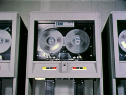 1957 early computer tape drives with 'IBM' logo spinning / Air Force SAGE computer