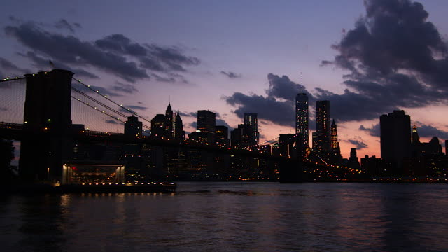 Early evening shot of Brooklyn Bridge with Manhattan and the One World Trade Center in the background.