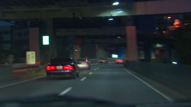 T/L WS POV Early evening traffic on ramps around Shibuya, Shibuya, Tokyo, Japan