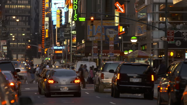 early evening view of the broadway district including neon and traffic - broadway show stock videos and b-roll footage