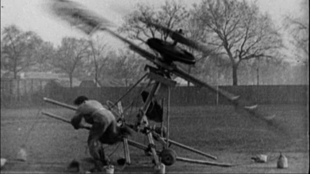 stockvideo's en b-roll-footage met early helicopter invention tips over nearly crushing man early failed flight invention on january 01 1915 in unspecified - 1915