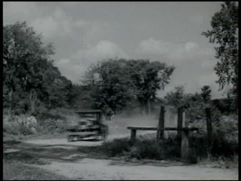 speeding early model car driving fast on curved country dirt road in france - 1935 stock videos and b-roll footage