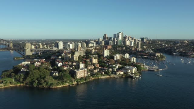 early morning aerial drone vision of quiet sydney harbour due to covid19 eastern side of the harbour bridge the drone captured some stunning wide... - seabed stock videos & royalty-free footage