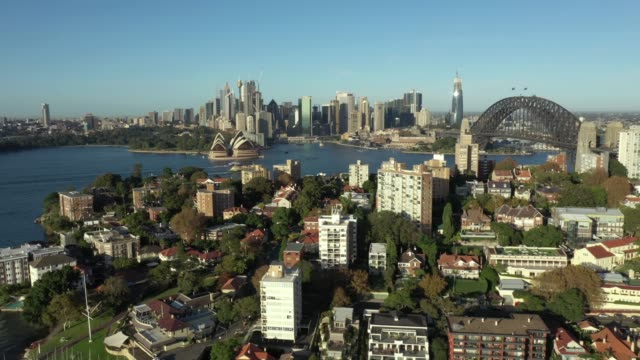 early morning aerial drone vision of quiet sydney harbour due to covid-19, eastern side of the harbour bridge. the drone captured some stunning wide... - hitting stock videos & royalty-free footage