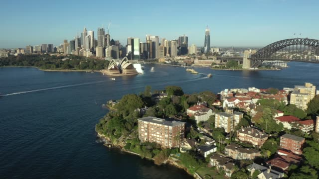 early morning aerial drone vision of quiet sydney harbour due to covid19 eastern side of the harbour bridge the drone captured some stunning wide... - hitting stock videos & royalty-free footage