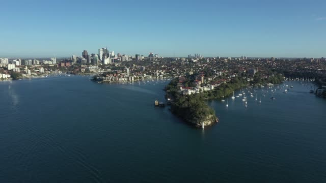 early morning aerial drone vision of quiet sydney harbour due to covid-19, eastern side of the harbour bridge. the drone captured some stunning wide... - coastline stock videos & royalty-free footage