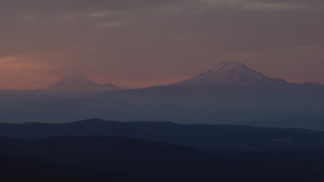 Early morning aerial of Mount Hood and Mt. St. Helen in background.