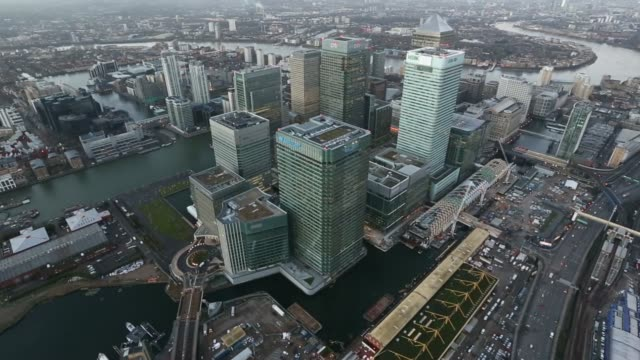 early morning aerial view shows no 1 canada square skyscraper offices surrounded by the office buildings of global financial institutions including... - canary wharf stock videos & royalty-free footage