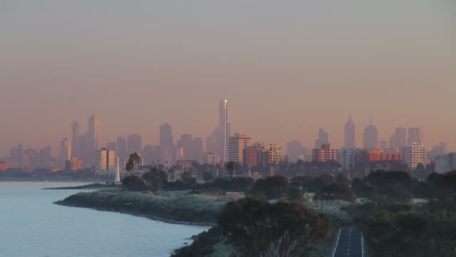 ws early morning joggers and cyclists exercising near st kilda beach / melbourne, victoria, australia - morning stock videos & royalty-free footage