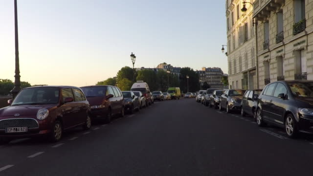early morning on the quai aux fleurs. ile de la cite. - moving process plate stock videos and b-roll footage