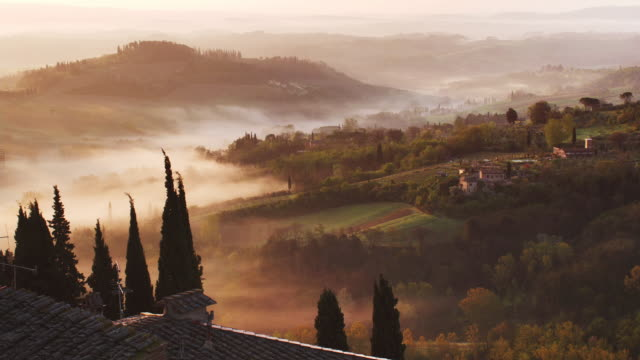 early morning over valley - collina video stock e b–roll