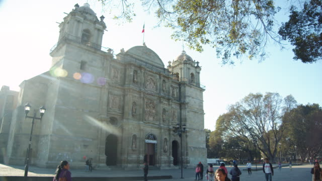 early morning sunlight on oaxaca cathedral in oaxaca city, mexico - religious equipment stock videos & royalty-free footage