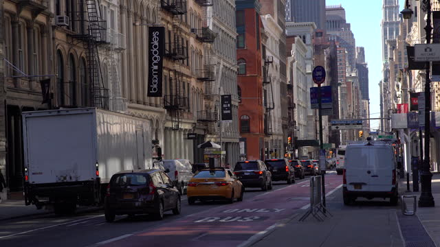 early morning traffic on lexington avenue, in new york city, ny, u.s. on thursday, april 8, 2021. - consumerism stock videos & royalty-free footage