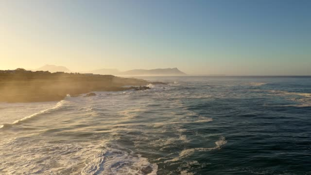 early morning video over the waves crashing along the cape coastline - cape town stock videos & royalty-free footage