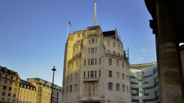 Early morning view of BBC broadcasting house at first light shadows pass across the facade of the building
