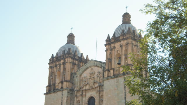 early morning view of oaxaca cathedral in downtown oaxaca city, mexico - religious equipment stock videos & royalty-free footage