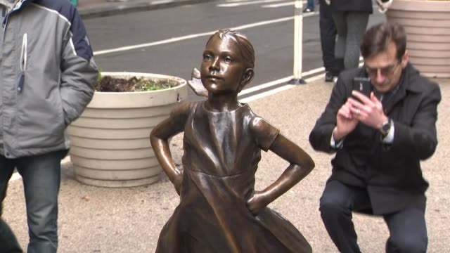 WPIX Early on the morning of March 7 State Street Global Advisors installed a statue of a defiant girl with hands on her hips chin high and pony tail...