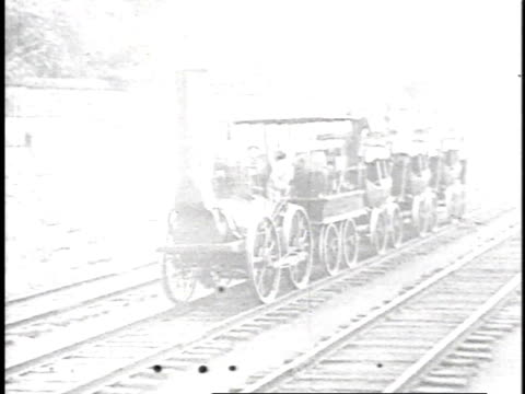 vídeos de stock, filmes e b-roll de 1923 reenactment early railway locomotive riding tracks and billowing smoke / united states  - 1923